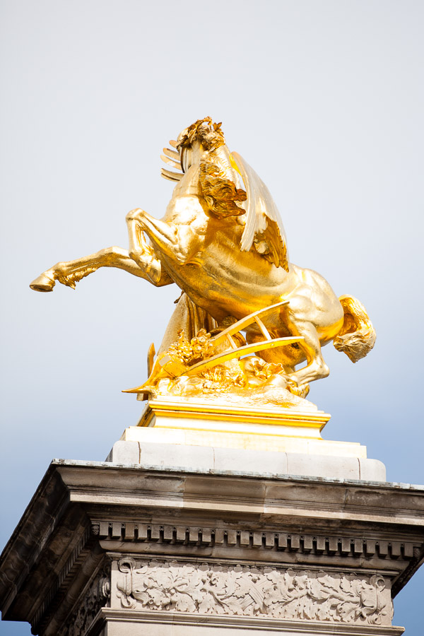 One of the gilded statues at Pont Alexandre III